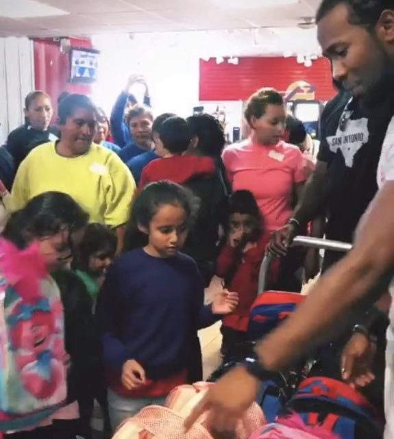 Josh gives out backpacks to children released from detention centers